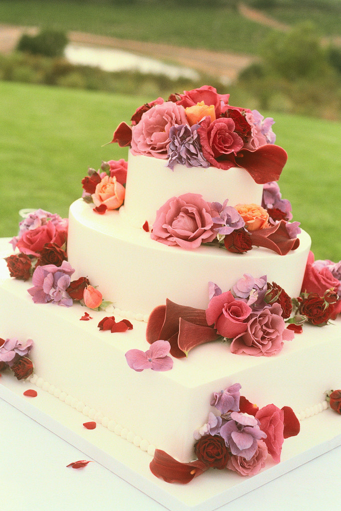 ca. 2001 --- Cake Decorated with Fresh Flowers --- Image by © Royalty-Free/Corbis